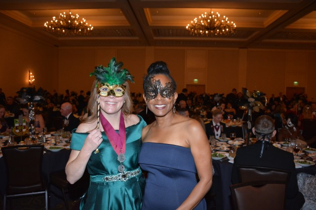 Attendees at the 2019 MEDCoE Holiday Ball donned masquerade for the themed event.  (Pictured left to right: Roxanne O'Neal and Sherry Sargent, MEDCoE Command Team Spouses).