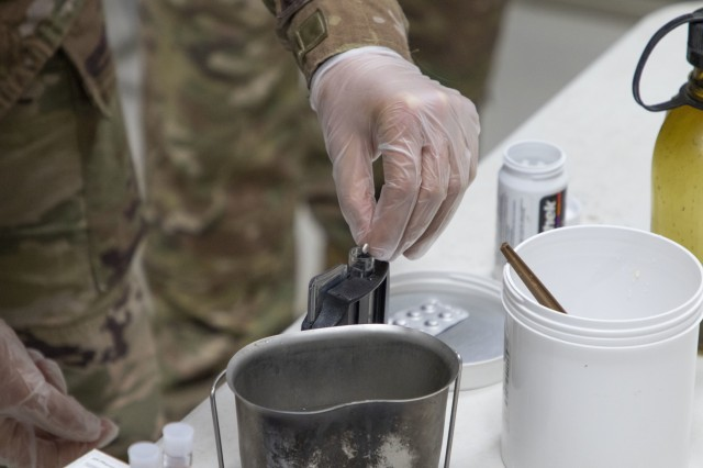 U.S. Army Spc. Shelby Vermeulen, with 1st Squadron, 303rd Cavalry Regiment, 96th Troop Command, Washington Army National Guard, drops a chlorine tablet into water during a Field Sanitation Team Certification Course held from Dec. 9 - 13, 2019 at Joint Training Center-Jordan. Soldiers must be ready and capable to conduct the full range of military operations to defeat all enemies regardless of the threats they pose.