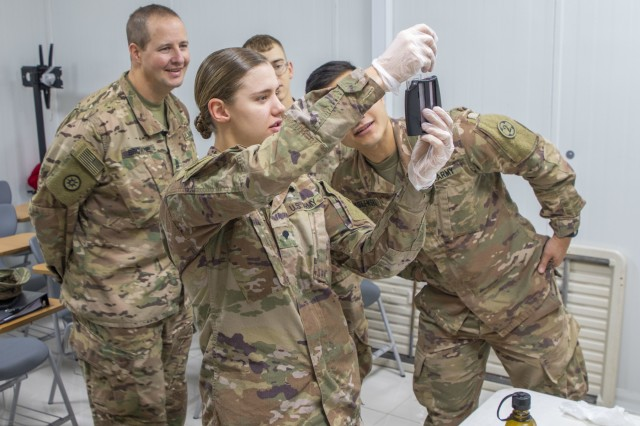 U.S. Army Spc. Shelby Vermeulen (center), with 1st Squadron, 303rd Cavalry Regiment, 96th Troop Command, Washington Army National Guard, tests a water sample for chlorine residuals during a Field Sanitation Team Certification Course held from Dec. 9 - 13, 2019 at Joint Training Center-Jordan. Soldiers must be ready and capable to conduct the full range of military operations to defeat all enemies regardless of the threats they pose.