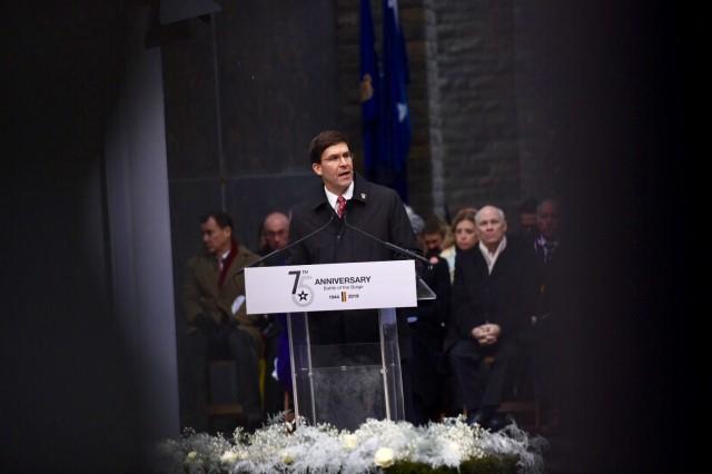 Defense Secretary Dr. Mark T. Esper speaks during a ceremony marking the 75th anniversary of the Battle of the Bulge at the Mardasson Memorial near Bastogne, Belgium, Dec. 16, 2019.
