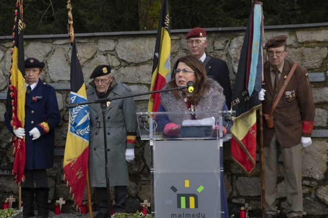 Stephanie Domitrovich, the daughter of a survivor of the Malmedy Massacre, speaks at a ceremony in Malmedy, Belgium, Dec. 15, 2019, recognizing the 75th anniversary of the massacre. The ceremony honored the victims of the war crime as well as all veterans of World War II. DoD photo by Sgt. Erica Earl / Released