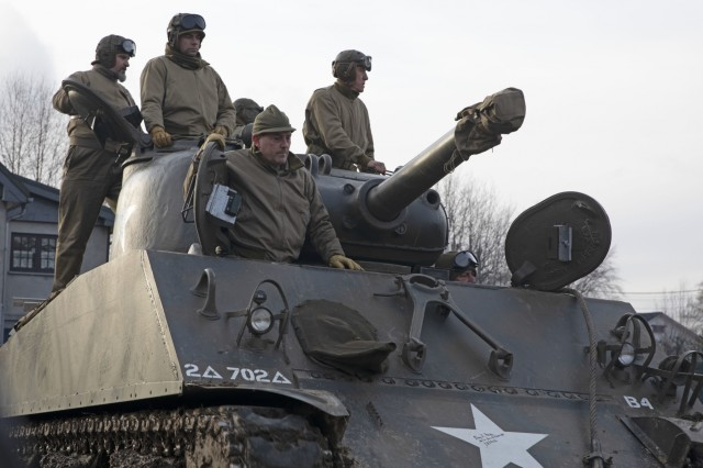 Reenactors ride on a Sherman tank at a ceremony on Dec. 15, 2019, recognizing the 75th anniversary of the Malmedy Massacre in Malmedy, Belgium. The ceremony honored the fallen Soldiers who were victims of the massacre and those who fought in World War II. DoD photo by Sgt. Erica Earl / Released