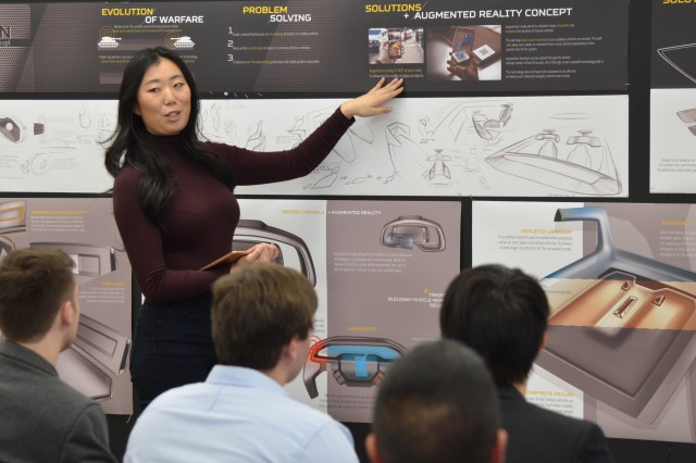 College for Creative Studies transportation design student Arianna Quan briefs her interior design concepts for future combat vehicles to engineers from the U.S. Army Ground Vehicle Systems Center. (U.S. Army photo by Jerome Aliotta/released)