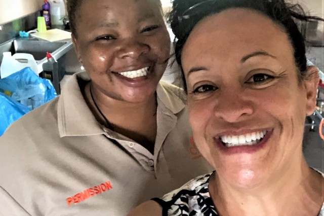 Cammy shares a light moment with staff member Permission Ngobeni as she says farewell to three weeks in South Africa.