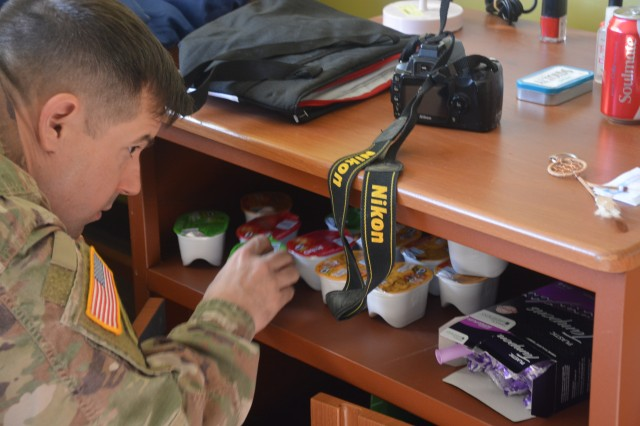 1st Sgt. John Depto, 706th Military Intelligence Group, searches a nightstand for drug paraphernalia and contraband inside a mock barracks room.