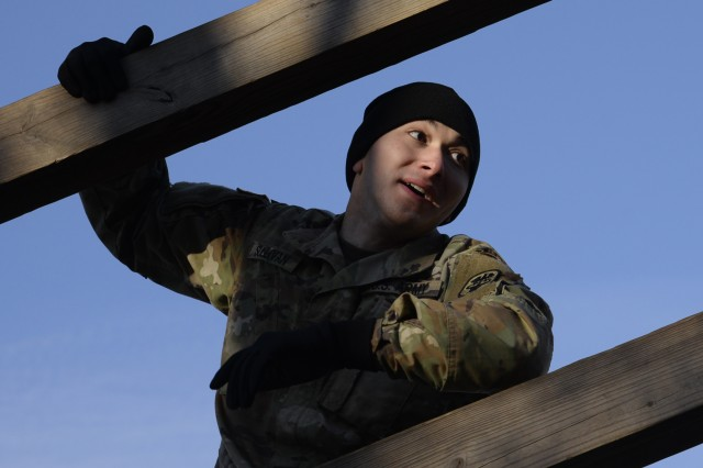 Spc. David Sullivan, GLWACH optical lab specialist, hangs about 30 feet in the air as he negotiates the confidence climb.