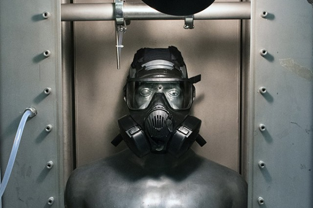 An M50 protective mask is affixed to SMARTMAN (Simulant Agent Resistance Test Manikin) prior to challenging then mask with Joint General Purpose Decontaminant for Hardened Military Equipment (JGPD HME).