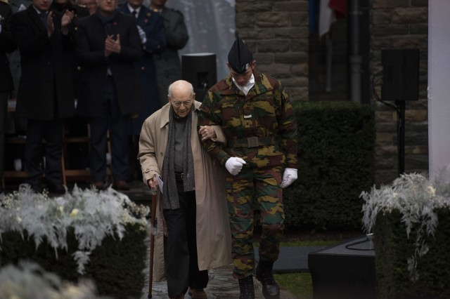 """Battle of the Bulge veteran Malcolm """"Buck"""" Marsh, A Company, 36th Infantry Regiment, 3rd Armored Division, takes part in the ceremony for the 75th anniversary of the Battle of the Bulge at the Mardasson Memorial in Bastogne, Belgium, Dec. 16, 2019."""