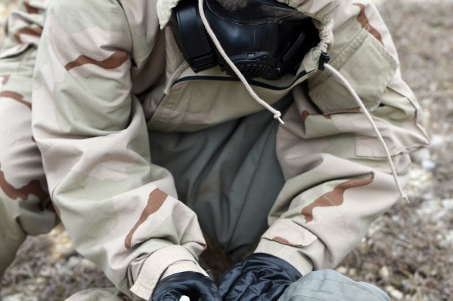 A Soldier simulates using a CBD auto-injector device on casualty during a field test at Camp Bullis, TX.