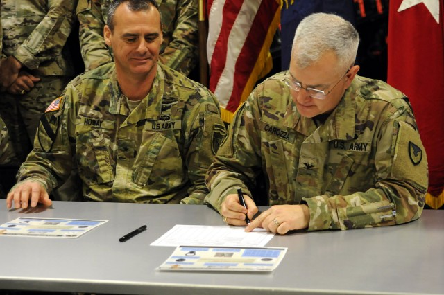 Kentucky National Guard hosted a ceremonial equipment signing Dec. 17, 2019 at the USPFO in Frankfort, Kentucky, with Col. Steven Carozza (right), military deputy director for TACOM Integrated Logistics Support Center and Brig. Gen. Bryan Howay (left), director of the Joint Staff for the Kentucky National Guard.