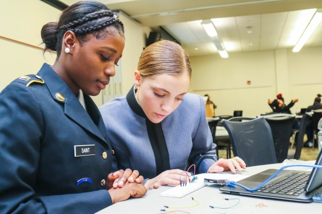 Class of 2022 Cadet Amanda Martin works with high school student Roberteliane Seant, 10th, to build a circuit during the West Point Office of Diversity, Inclusions and Equal Opportunity's LEADS event in Philadelphia Dec. 13, 2019.