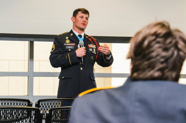 Staff Sgt. Dakota A. Bowen, U.S. Army noncommissioned officer of the year, talks to high school students during the West Point Office of Diversity, Inclusions and Equal Opportunity's LEADS event in Philadelphia Dec. 13, 2019.
