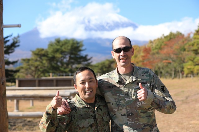 Sgt. 1st Class Galen E. Corbell, air defense battle management systems operator, 38th Air Defense Artillery Brigade, and Sgt. 1st Class Seigo Harumoto, communications noncommissioned officer in charge, 3rd Antiaircraft Artillery Regiment, Japan Ground Self-Defense Force, complete an obstacle course together during the brigade's Situation Training Exercise at Camp Fuji, Japan Nov. 15, 2019. Corbell was Harumoto's sponsor during the 10-week U.S. Army Japan Cooperative Work Program, signifying the first time air defenders participated to enhance the U.S.-Japan partnership.