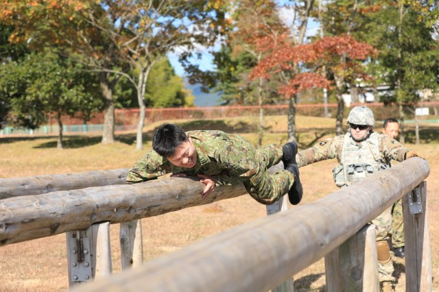 1st Lt. Kenta Kita, air defense artillery officer, 7th Antiaircraft Artillery Regiment, Japan Ground Self-Defense Force, negotiates an obstacle course during the 38th Air Defense Artillery Brigade's Situational Training Exercise at Camp Fuji, Japan Nov. 15, signifying the first time air defenders have participated in the U.S. Army Japan Cooperative Work Program to enhance the U.S.-Japan partnership.