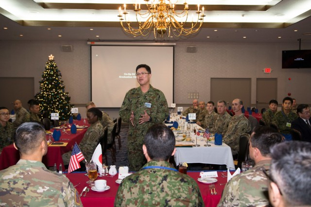 1st Lt. Kenta Kita, air defense artillery officer, 7th Antiaircraft Artillery Regiment, Japan Ground Self-Defense Force, speaks to U.S. Army Japan leadership about his experience with the USARJ Cooperative Work Program during the graduation ceremony, concluding the 10-week program at Camp Zama, Japan Dec. 13, 2019, signifying the first time air defenders participated in the program since its inception in 1995.