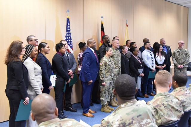 Fifteen transitioning service members from throughout Europe graduate from the Department of Veterans Affairs' Warrior Transition Advancement Course at a ceremony Dec. 19 at Sembach Kaserne, Germany. Fourteen Soldiers and one Airman attended the 10-week course to learn skills needed to become Veterans Service Representatives and handle VA disability claims.