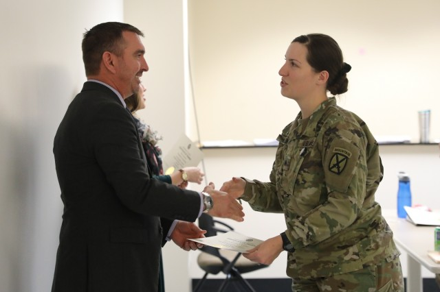 Sgt. Samantha Nevling, the 10th Mountain Division Space Support Element noncommissioned officer in charge, receives her Army Space Cadre Basic Course certificate after completing the two-week-long course, Dec. 13 at Fort Drum, N.Y. The course provides Soldiers knowledge on the fundamentals of space capabilities, and space systems and organizations to help them better understand their roles in the space community.