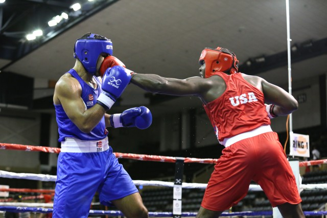 Sgt. Adrian Tillman (right) boxing in the men's 95kg weight class at the 2019 U.S. Boxing Olympic trails in Lake Charles, Louisiana. Tillman boxed in two rounds.