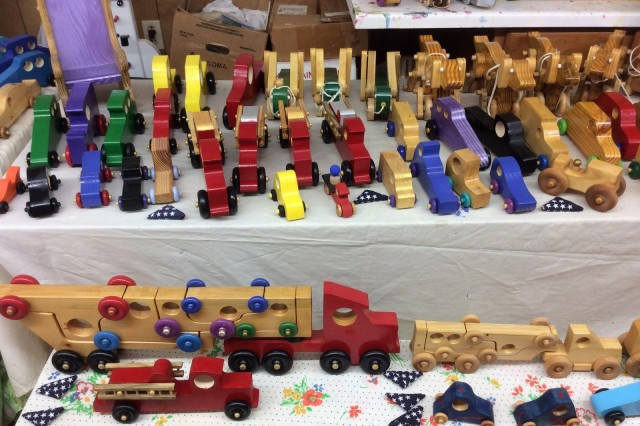 Collection of handmade wooden toys on display inside Jim Annis' woodshop in Sanford, N.