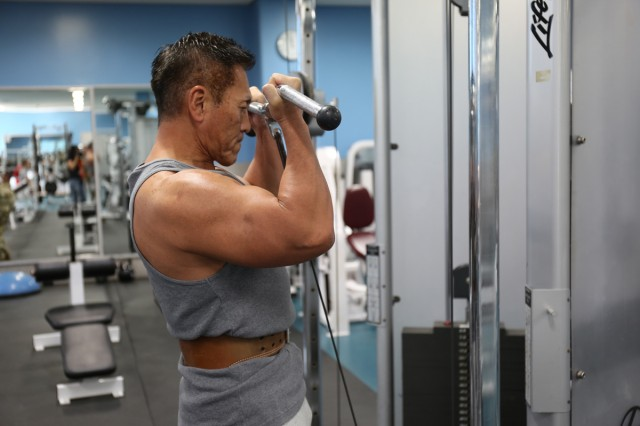 Kaoru Hashiguchi, an accounting technician with the 78th Signal Battalion at Camp Zama, Japan, works out Nov. 5 at the Yano Fitness Center there. Hashiguchi, 56, began training eight years ago to be a competitive bodybuilder and works out daily at Yano.