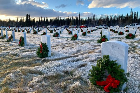 U.S. Army Alaska and Joint Base Elmendorf-Richardson leaders, along with Gold Star Families and community members, remember the fallen and honor military veterans as part of Wreaths Across America, Dec. 14, at Fort Richardson National Cemetery. Following the ceremony, they joined community members and volunteers in placing the nearly 4,000 donated wreaths at head stones throughout the cemetery.