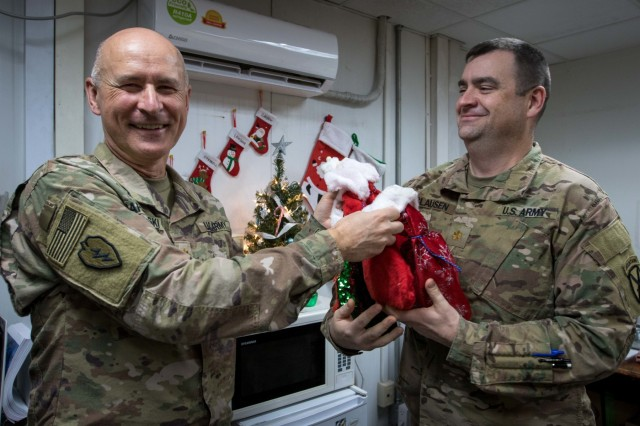 Soldiers from 10th Combat Aviation Brigade, 10th Mountain Division (LI), receive stockings sent from the United States Dec. 14, at Bagram Air Field, Afghanistan. The stockings were delivered to Fort Drum, N.Y, where they were dispersed among 2nd Battalion, 22nd Infantry Regiment, 1st Brigade Combat Team Soldiers, and 10th Combat Aviation Soldiers currently deployed in Afghanistan. Esposito's son, Michael Esposito was a 2nd Bn., 22nd Inf. Reg. Soldier who was killed in action in Afghanistan on March 18, 2004.