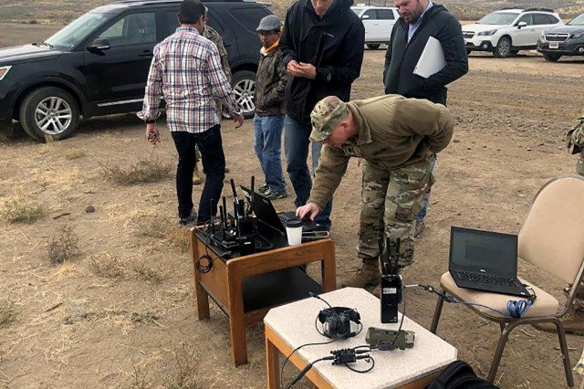 PEO C3T and Network Cross-Functional Team members and vendors assess commercial waveform strength during their Rapid Innovation Fund capstone event at Yakima Training Center. (Photo courtesy of PEO C3T Public Affairs)