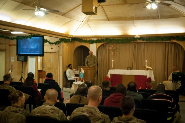 U.S and International service members deployed to Afghanistan celebrated Christmas Eve late Wednesday, December 24 on Kandahar Airfield with mass held at Fraise Chapel.The service, led by Army Chaplain Col. Jim Krische, gave service members an opportunity to fellowship and celebrate the holiday with their brothers and sisters in arms.