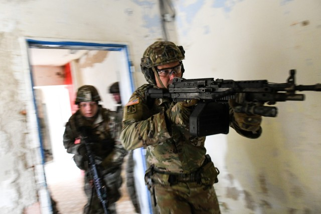 Spc. Jerrad Nicholson, with the Indiana Army National Guard's 1st Squadron, 152nd Cavalry Regiment, leads Soldiers into a room during Slovak Shield 2019, a training exercise in Slovakia, Nov. 10, 2019, as part of the Defense Department's State Partnership Program.