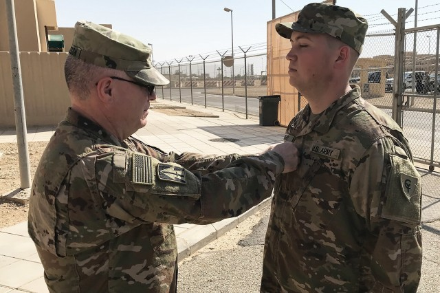 Indiana National Guard 1st Lt. Matthew Michael of Fort Wayne, a signal officer with the 38th Infantry Division, receives his new rank during his promotion ceremony in Saudi Arabia, Monday, Oct. 21, 2019. Michael is one of about 600 division soldiers who deployed to the Middle East in May to support Task Force Spartan, which helps strengthen defense relationships and build partner capacity within the region.