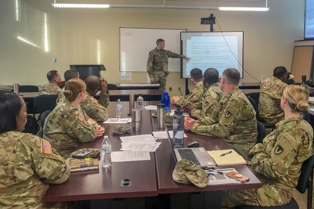 Capt. David Ray leads a quality assurance class for Soldiers during a contingency contract administration services training event in March at Fort Bragg, North Carolina. Ray is a 609th Contracting Team contract management officer at Fort Bragg. (Photo by Sgt. 1st Class Terry Ann Lewis)