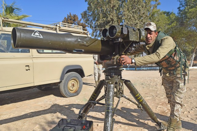 """A Jordan Armed Forces-Arab Army (JAF) Soldier looks through the scope of a BGM-71 Tube-launched, Optically-tracked, Wireless-guided Weapon System during a Subject Matter Expert Exchange with U.S. Army Soldiers of Charlie Company, 1st Combined Arms Battalion, 252 Armor Regiment, 30th Armored Brigade Combat Team, """"Old Hickory,"""" North Carolina Army National Guard, coordinated by Military Engagement Team-Jordan, 158th Maneuver Enhancement Brigade, Arizona Army National Guard, at a base outside of Amman, Jordan in December 2019. The U.S. military has a long-standing relationship with Jordan to support our mutual objectives by providing military assistance to the JAF consistent with our national interests."""