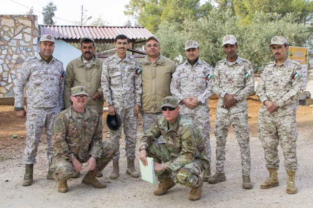 """Jordan Armed Forces-Arab Army (JAF) Soldiers pose with U.S. Army Soldiers from Charlie Company, 1st Combined Arms Battalion, 252 Armor Regiment, 30th Armored Brigade Combat Team, """"Old Hickory,"""" North Carolina Army National Guard, for a photo during a Subject Matter Expert Exchange on the BGM-71 Tube-launched, Optically-tracked, Wireless-guided Weapon System, coordinated by Military Engagement Team-Jordan, 158th Maneuver Enhancement Brigade, Arizona Army National Guard, at a base outside of Amman, Jordan in December 2019. The U.S. military has a long-standing relationship with Jordan to support our mutual objectives by providing military assistance to the JAF consistent with our national interests."""