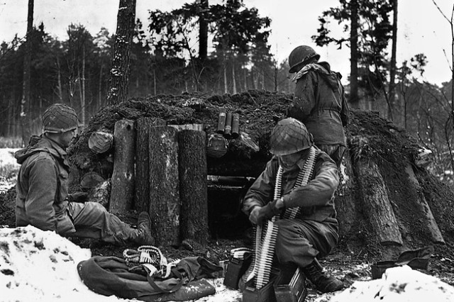 """U.S. Army Soldiers of the 42nd Infantry Division's Task Force Linden prepare a defensive position at their log and dirt bunker near Kauffenheim, France, on January 8, 1945. The Soldiers, assigned to Company I, 242nd Regiment, held off the German offensive in Alsace, France called Operation Nordwind without the division's artillery or support elements. The actions of one division Soldier, Master Sergeant Vito Bertoldo will be presented as part of the 2018 Netflix documentary series """"Medal of Honor."""" The series highlights stories of America's Medal of Honor recipients. Bertoldo, of Decatur, Illinois, received the Medal of Honor for his actions defending his battalion command post while assigned to the 42nd Infantry Division's 1st Battalion, 242nd Infantry Regiment in Hatten, France January 9-10, 1945. The Netflix series streams beginning November 9, 2018."""