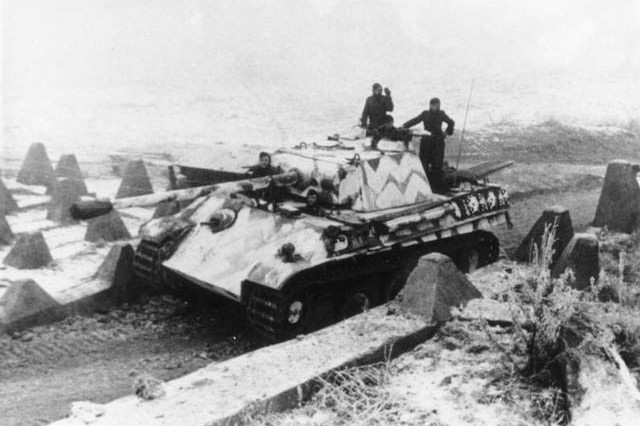 """A German Panther tank of the 25th Panzer Division crosses a checkpoint near Wissembourg, France, about 37 miles north of Strasbourg, January 6, 1945, during the opening phase of the German offensive known as Operation Nordwind in World War II. The Germans attacked Alsace, France and met resistance from American and French forces. The actions of one 42nd Division Soldier, Master Sergeant Vito Bertoldo, will be presented as part of the 2018 Netflix documentary series """"Medal of Honor."""" The series highlights stories of America's Medal of Honor recipients. Bertoldo, of Decatur, Illinois, received the Medal of Honor for his actions defending his battalion command post while assigned to the 42nd Infantry Division's 1st Battalion, 242nd Infantry Regiment in Hatten, France January 9-10, 1945. The Netflix series streams beginning November 9, 2018."""