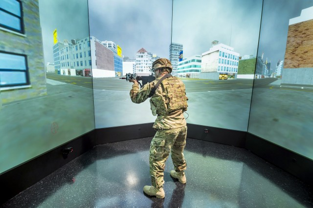 A Soldier navigates through the augmented reality lab at the Center for Applied Brain and Cognitive Sciences, a cooperative research initiative between Tufts University School of Engineering and CCDC's Soldier Center. The center conducts applied research on measuring, predicting and enhancing cognitive capabilities and human system interactions for individuals and teams working in high-stakes environments. (Photo by David Kamm, CCDC Soldier Center)