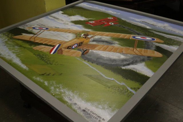 The murals were copied onto plywood to make them portable as Company C2 moves into new barracks.