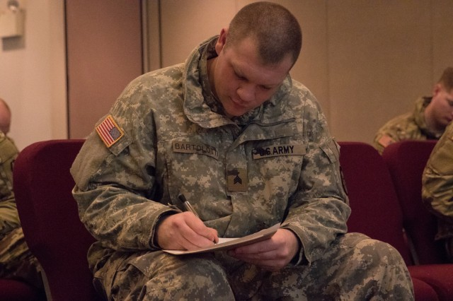 U.S. Army Sgt. Samuel Bartolotti, a sergeant with Company C, 70th Brigade Engineer Battalion, 1st Styker Brigade Combat Team, 25th Infantry Division, fills out a survey at Connection Life Purpose System training at Northern Lights Chapel on Fort Wainwright on December 17th, 2019. Connection Life Purpose Strategy is a way for Soldiers to foster healthy relationships at the unit as well as purpose through service to each other and community. (U.S. Army photo taken by Sgt. Nicholas Vidro, 1 Stryker Brigade Combat Team, 25th Infantry Division Public Affairs)