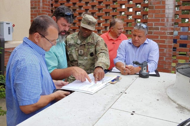 Sgt. 1st Class Kevin McClatchey conducts a site visit with members of the Department of Public Works in September at Fort Bragg, North Carolina, in preparation for a contract award for minor construction. A MICC pilot project related to base operations contracts reduced procurement action lead time from 250 days to approximately 130 days. (Photo by Capt. Steve Voglezon, MICC)