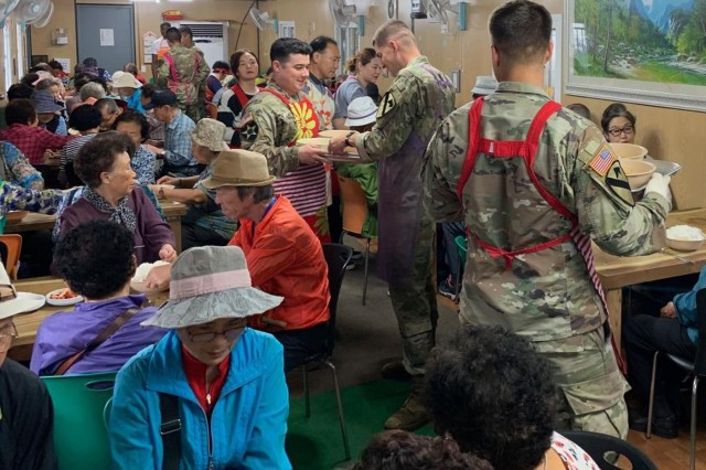 Republic of Korea--Soldiers from Headquarters and Headquarters Company, 1st Battalion, 12th Cavalry Regt., 3rd Armored Brigade Combat Team, 1st Cavalry Division serve food at a soup kitchen here. Soldiers from the Greywolf Brigade have been volunteering throughout their nine-month rotation to build relationships and give back to the Korean people.