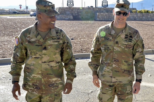 Command Sgt. Maj. Timothy A. Guden (right), of the U.S. Army Training and Doctrine Command, walks with Command Sgt. Maj. Jimmy Sellers (left) the commandant of the NCO Leadership Center of Excellence during his arrival to speak to the students from the Sergeants Major Course Class 70, Dec. 19.