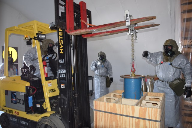 BGCA personnel demonstrate how to containerize a leaking chemical munition during an inspection.