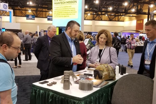 Dr. James Zunino, CCDC Armaments Center, discusses the latest Army textile and additive manufacturing prototypes with Dr. Lisa Porter, deputy Under Secretary of Defense for Research and Engineering, at the Defense Manufacturing Conference ManTech booth in December 2019.