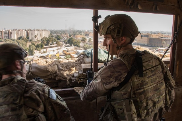 U.S. Soldiers stand overwatch at the U.S. Embassy compound in Baghdad, Jan. 1, 2020.