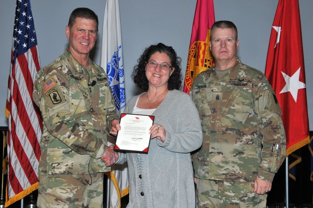 U.S. Army Tank-automotive and Armaments Command's Security Manager, Michelle McCarthy (center), receives a letter of appreciation from TACOM Commanding General, Maj. Gen. Dan Mitchell (left), during a town hall on Dec. 4, 2019.