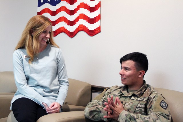 Jennifer Kirby, USO Oklahoma senior director, chats with Spc. Sean Reyes, 2nd Battalion, 20th Field Artillery, Jan. 8, 2020, at the Fort Sill USO Center. The center recently received a $15,000 donation from the niece and nephew of the original president of the USO.
