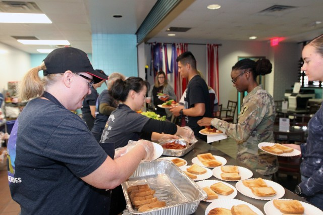 Fort Sill USO volunteers (left) serve a free lunch at the center Jan. 8, 2020. Wednesdays lunches are one of the many services the staff provides to service members and their families.
