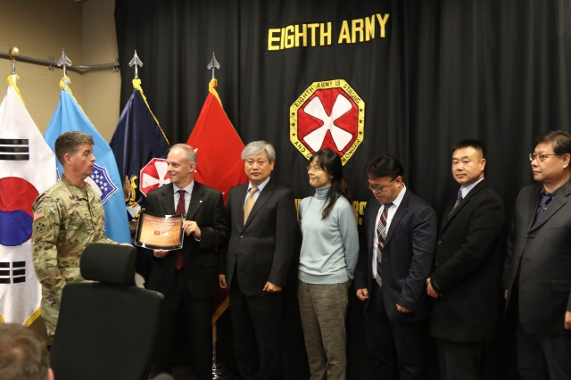 Maj. Gen. Patrick Donahoe, Eighth Army deputy commanding general, operations (left), presents the 2018 U.S. Army Chief of Staff and Secretary of the Army Organizational Excellence in Safety Award for Garrison to representatives from U.S. Army Garrison Daegu Safety Office Jan. 8, 2019, at Camp Humphreys, South Korea. (U.S. Army photo by Pfc. Ko, Bae-young)