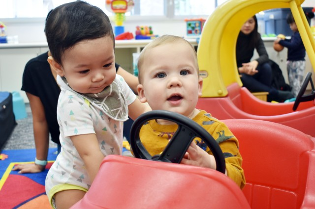 Axel Ramos, left, 10 months, plays with a toy car with Winston Keiper, 1, during the New Parent Support Program Playgroup at the Sagamihara Family Housing Area, Japan, Jan. 7.