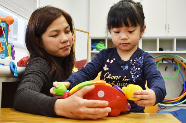Isabel DeGuzman plays with her daughter Cataleya, 3, during the New Parent Support Program Playgroup at the Sagamihara Family Housing Area, Japan, Jan. 7.